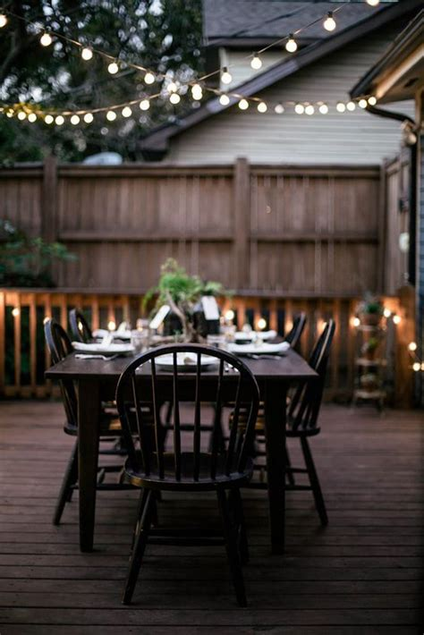 outdoor patio string lighting with seating areas