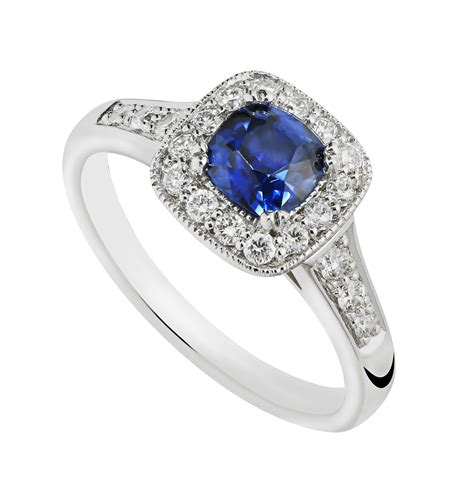 18ct white gold sapphire and 0 25 carat ring