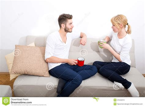 couple on sofa young couple talking on the sofa stock photo image 41542213