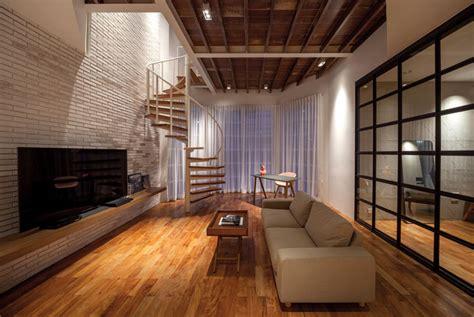 compact mezzanine apartment  spiral staircase