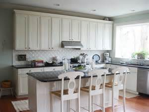 White Kitchen With Backsplash artistic white backsplash black countertop sink and faucet a kitchen