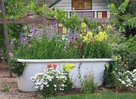 bathtub gardens 20 yard landscaping ideas to reuse and recycle old bathroom tubs for ponds and