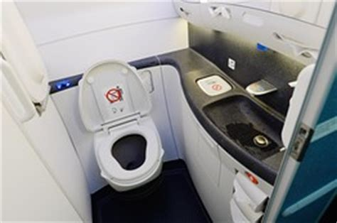 plane bathroom airlines lavs shrink to fit more seats the middle seat