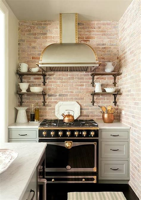 small white kitchen with steel hood stainless steel dome kitchen hood with brass trim and a