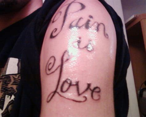 pain is love tattoo is picture
