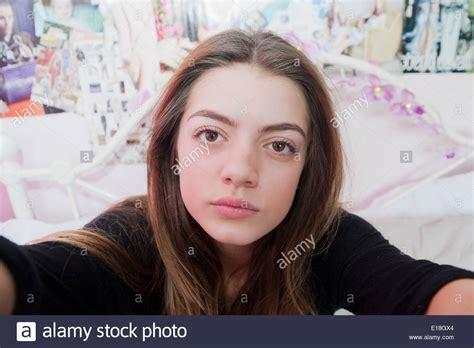 13yo selfie teenage 13 year old girl posing for a pretend selfie in