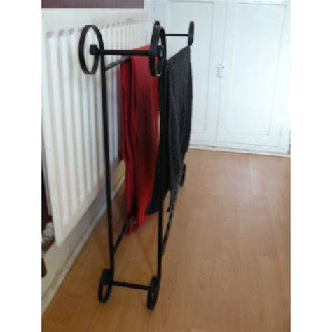 Wrought Iron Towel Rack by Wrought Iron Scrolled Towel Rail Storage Rack