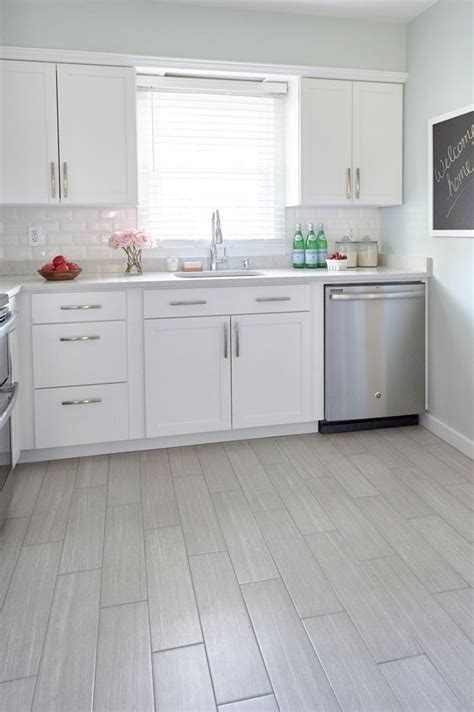 gray tile kitchen floor 25 best images about kitchen floors on