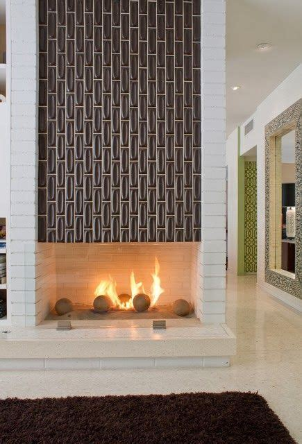 mid century tile a mid century modern two sided fireplace featuring tile