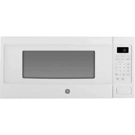 ge profile pem31dfww 1 1 cu ft countertop microwave