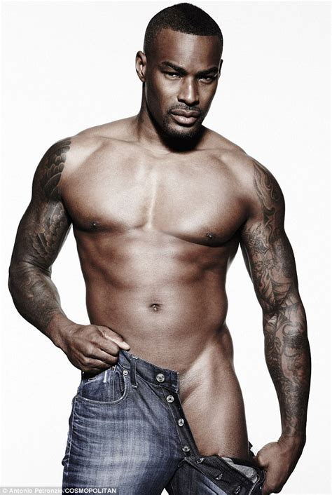 Tyson Beckford shows off his washboard abs in raunchy new