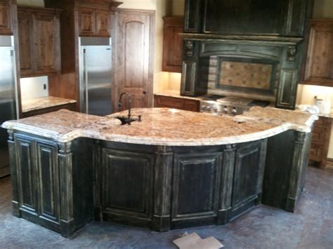 Betularie Granite Countertops by Betularie Granite With Black Gold Distressed Cabinets