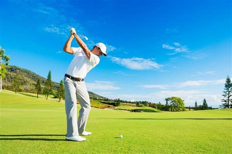 golf swing hitting behind the ball tutorial on how to hit a golf ball straight