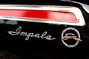 1962 chevrolet impala taillight and emblem photograph by