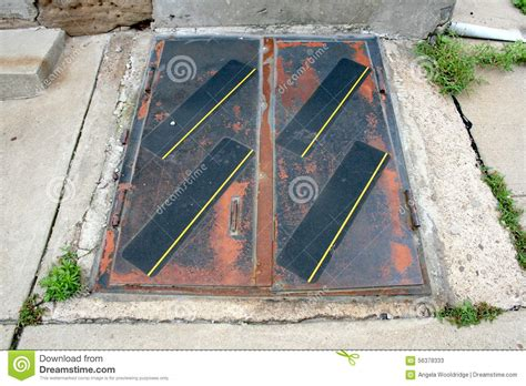 outdoor exterior rusted doors to stairs to basement floor
