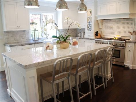 carrara marble kitchen island the perimeter countertops are white quartzite with a mitered edge detail the island