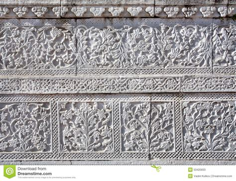 tile pattern rakatan temple floral patterns on texture of ancient temple stock photo