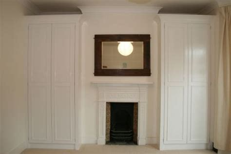 Built In Wardrobes Around Fireplace by Alcove Carpentry Ltd Bespoke Furniture Maker In