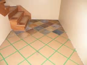 Hand painted faux slate tile floor on concrete floor