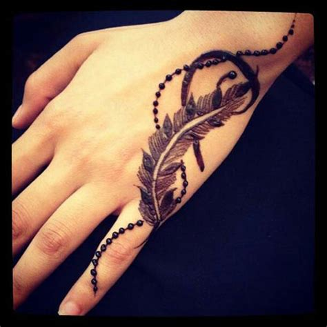 feather tattoo on hand 19 beautiful feather henna designs you will to try