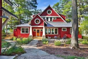 Gorgeous little red painted cottage in the woods created by mac custom