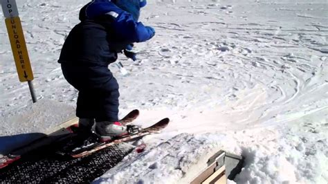 1 year skiing teaching my 2 year to snow ski