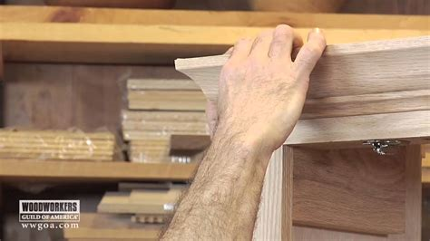 applying wood trim to old kitchen cabinet doors woodworking diy project installing crown molding on a