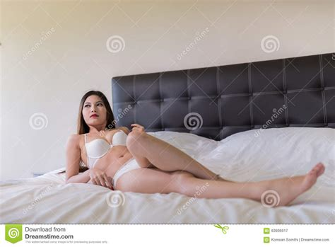 how to look sexier in bed sexy beautiful brunette woman lying in bed in sensual