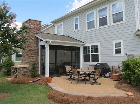 screened porch screened porch with wood burning fireplace and paver patio