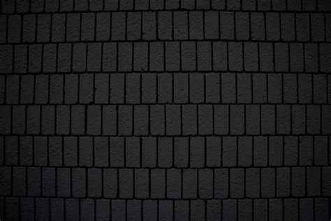 black brick wall black brick wall texture with vertical bricks picture