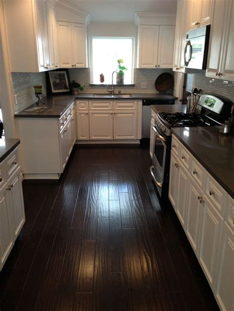kitchen with wood floors and white cabinets dark brown granite countertops with white cabinets www