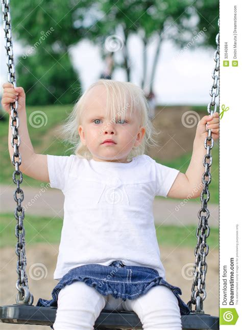 little girl on swing little girl on swing stock images image 32040884