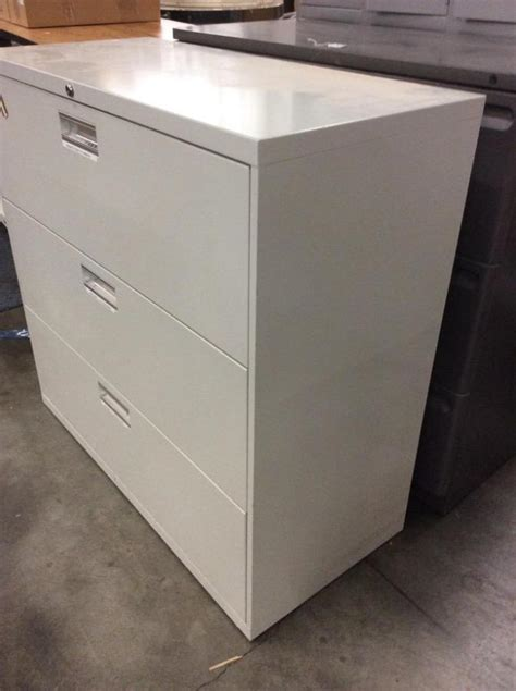 a 3 drawer colored metal filing cabinet