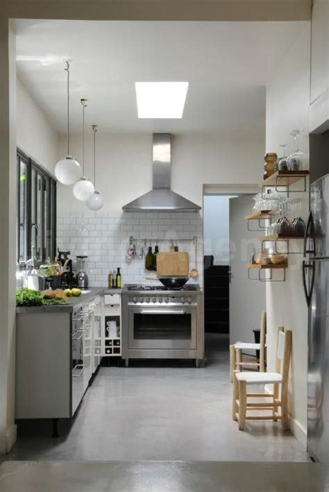 wall hood with tile   Subway tile stops under hood and
