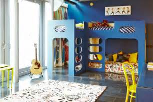 Blue and white kids boys room design with modern blue wooden loft bed