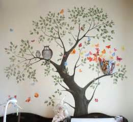 Tree wall painting and a bed with four tree posts bedroom decorating