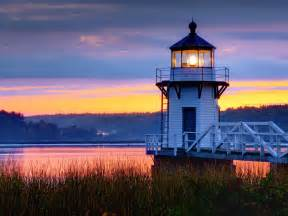 lighthouse on a coast during evening wallpaper