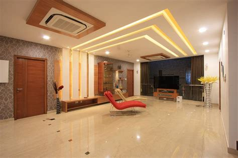 Interior Design Tamilnadu by View Of Simple And Sleek False Ceiling And Courtyard In The Family Room Divided By Glass And
