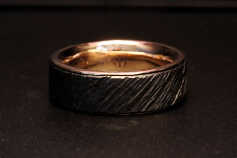 custom s iron and gold wedding ring by dailing