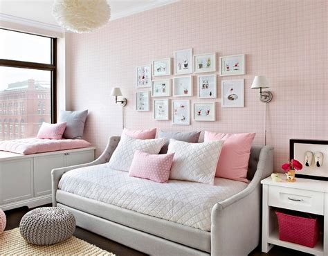 pink and brown girls bedroom with gray tufted beds pink and gray bedroom with pink door and gray tufted