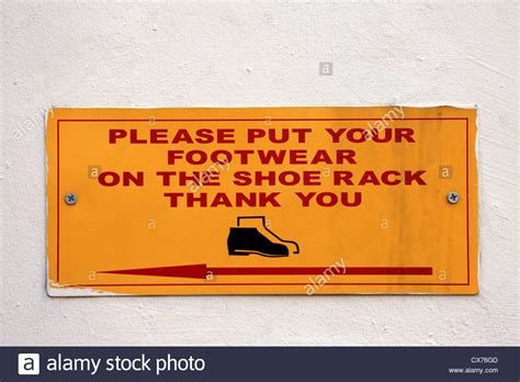 Put Your Shoes On The Rack by Place Footwear On Shoe Rack Sign Stock Photo