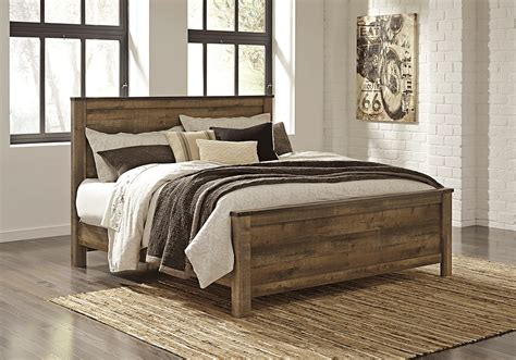panel bed trinell brown king panel bed