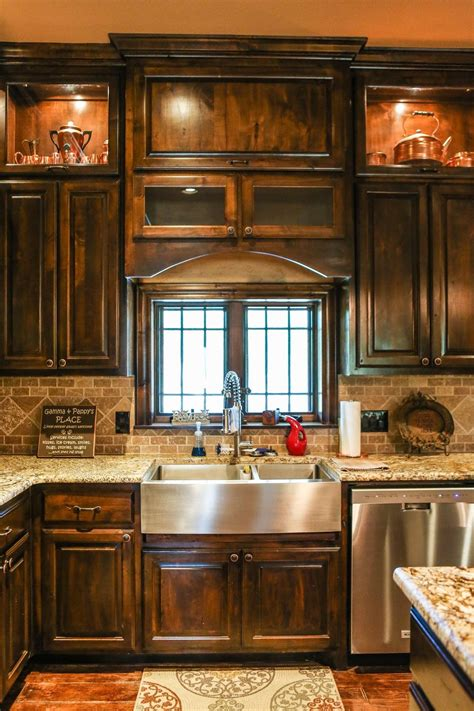 dark cabinets rustic kitchen  farmhouse sink rustic