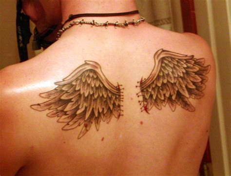 small angel wing tattoos on back small wing on the back busbones