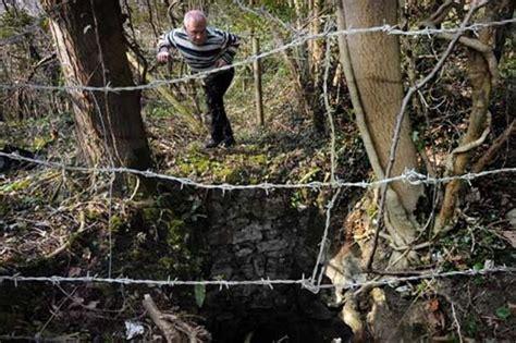 braune lederstühle disused mine shaft opens next to footpath in flintshire