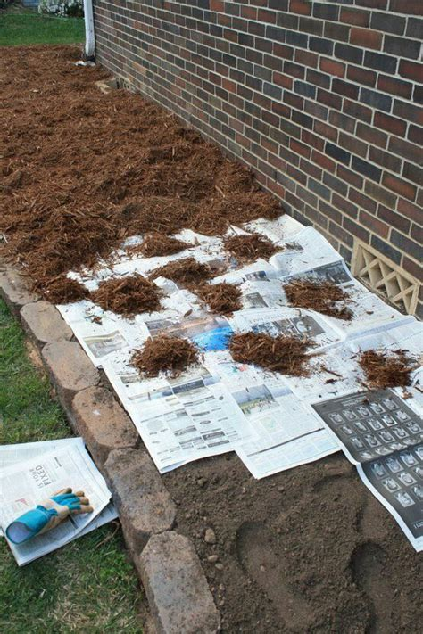 how to keep weeds out of flower beds newspaper is used to keep out the weeds and crapola d