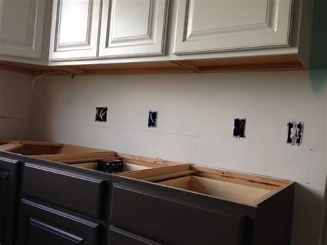 Lower Kitchen Cabinets Should The Underside Of White Painted Semi Custom Upper