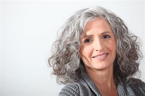 women over 55 with permed long hair naturally curly hairstyles curly hair silver curls