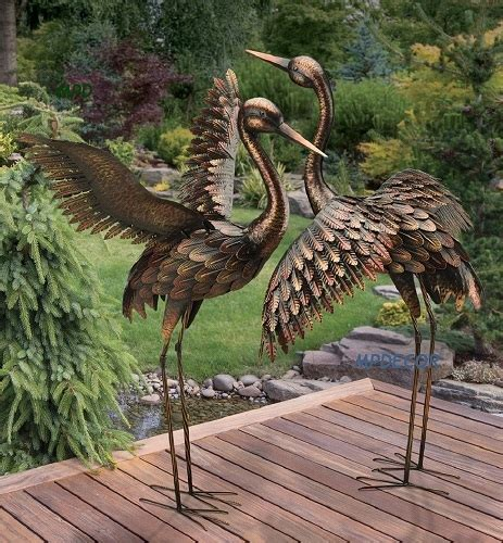 large bronze patina flying crane pair sculpture heron bird