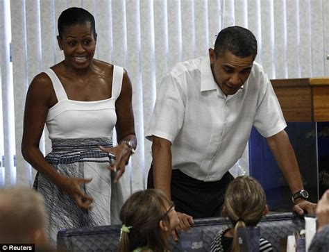 recent photo michele obama with no wig the obamas make a christmas visit to the troops and